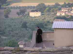 Friar on rooftop