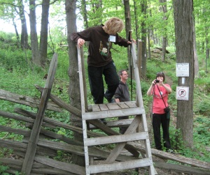 LeAnn climbs over the stile as John and Melissa watch